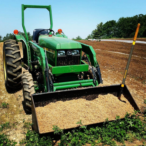 """My new/old 1986 John Deere 1050 full of spent brewers' grains.36 hp, and it fits just-so over our 30"""" beds."""