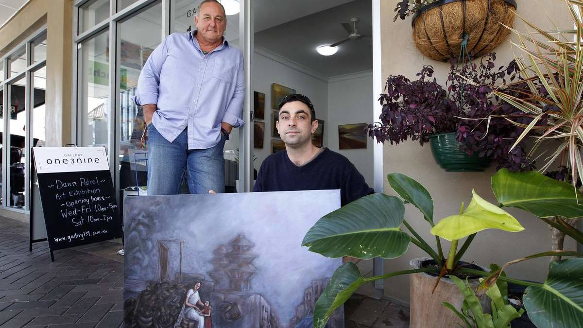 Justin Bergholcs, left, and Ben Kenning with one of the powerful Nepali artworks. Picture: Max Mason-Hubers