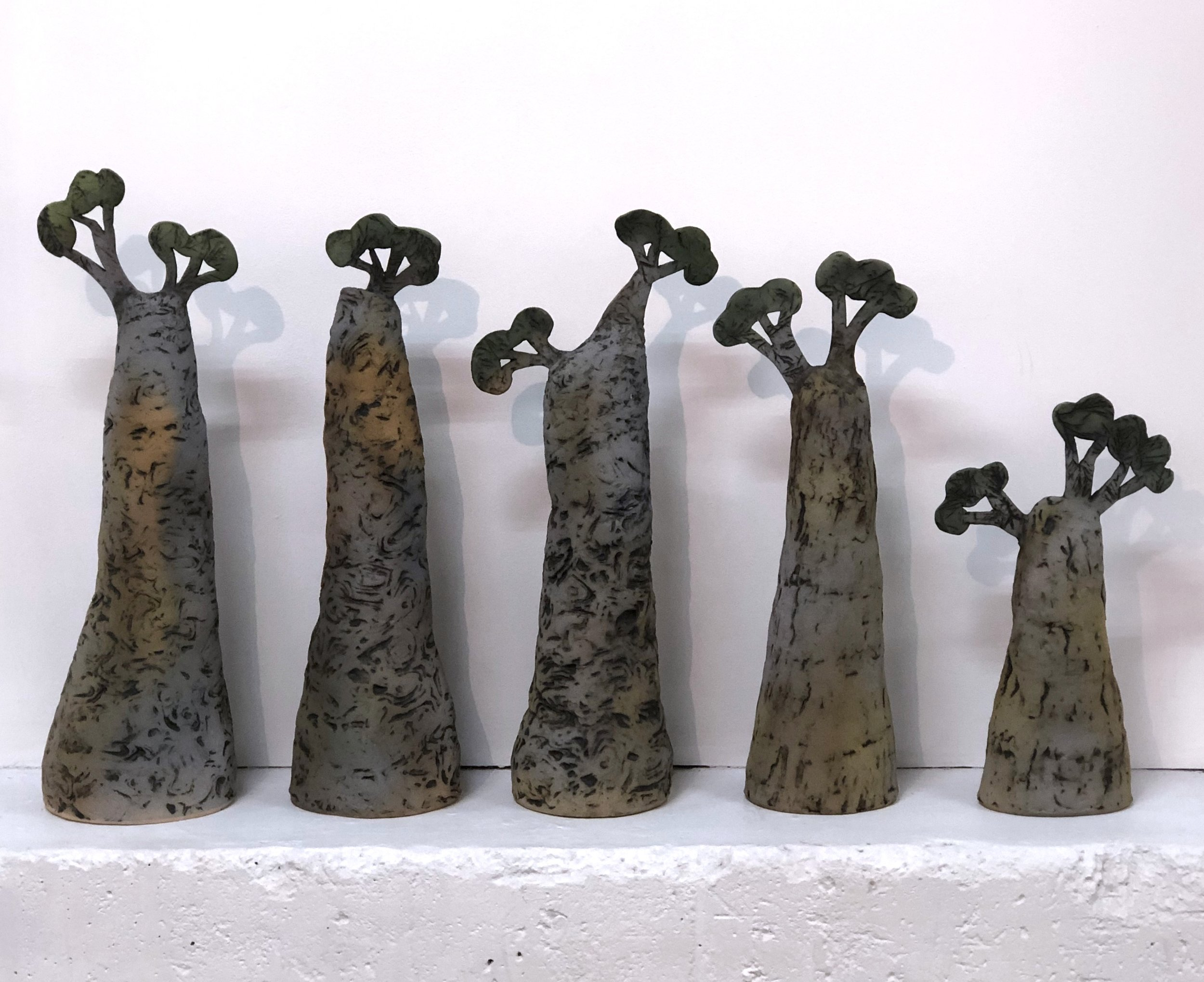 15. Sharon Taylor  The Gathering  ceramic installation various sizes $175.00each