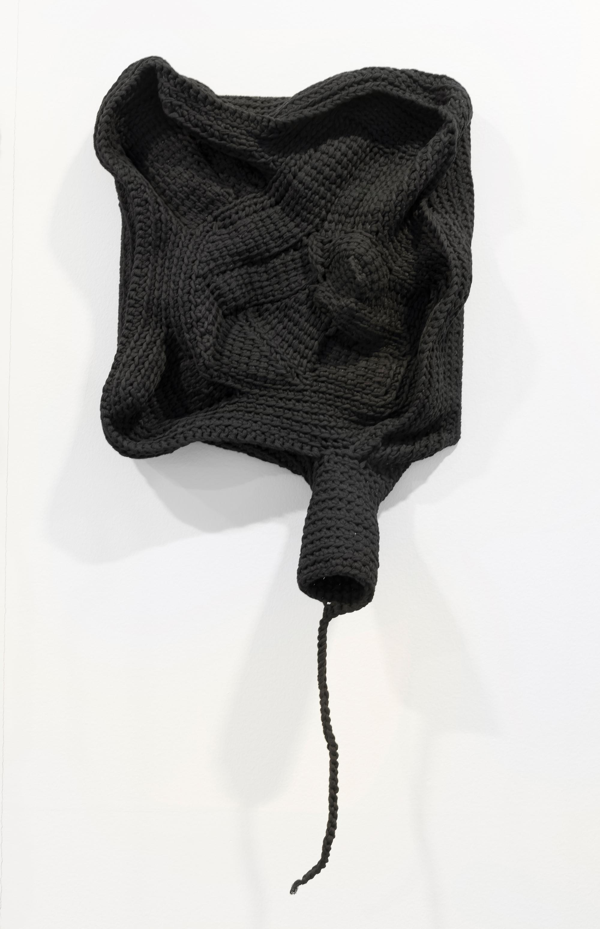 Leif Homstrand, fra serien  Breeder Covers  Clastoderma debaryanum: black, crocheted wall objects with individual slime mold-inspired subtitles.Foto:Øystein Thorvaldsen
