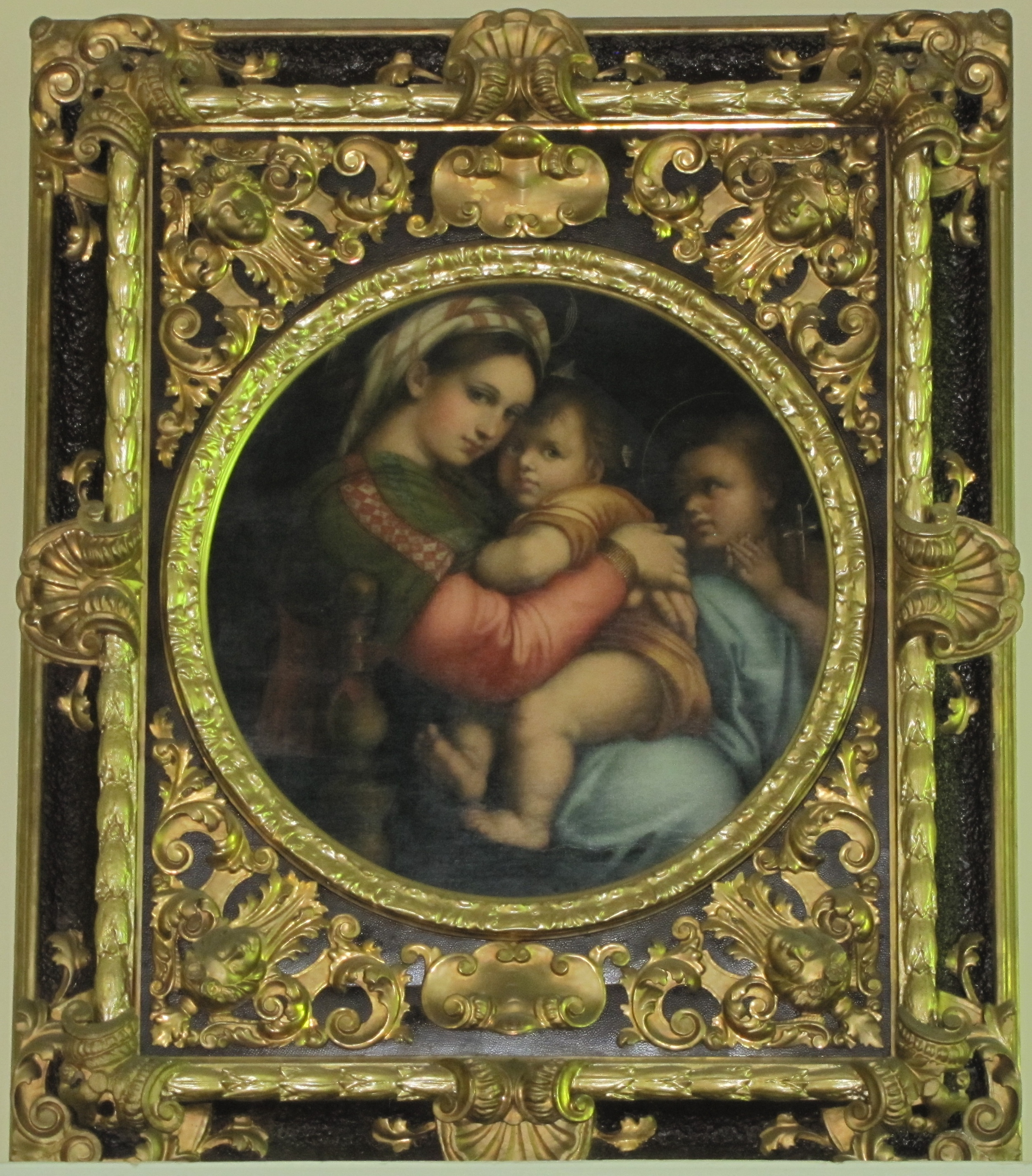 Hanging above the main entrance is this print of the Madonna, MADONNA DELLA SEDIA, taken from the original by Raphael, which hangs in the Pitti Palace in Florence.