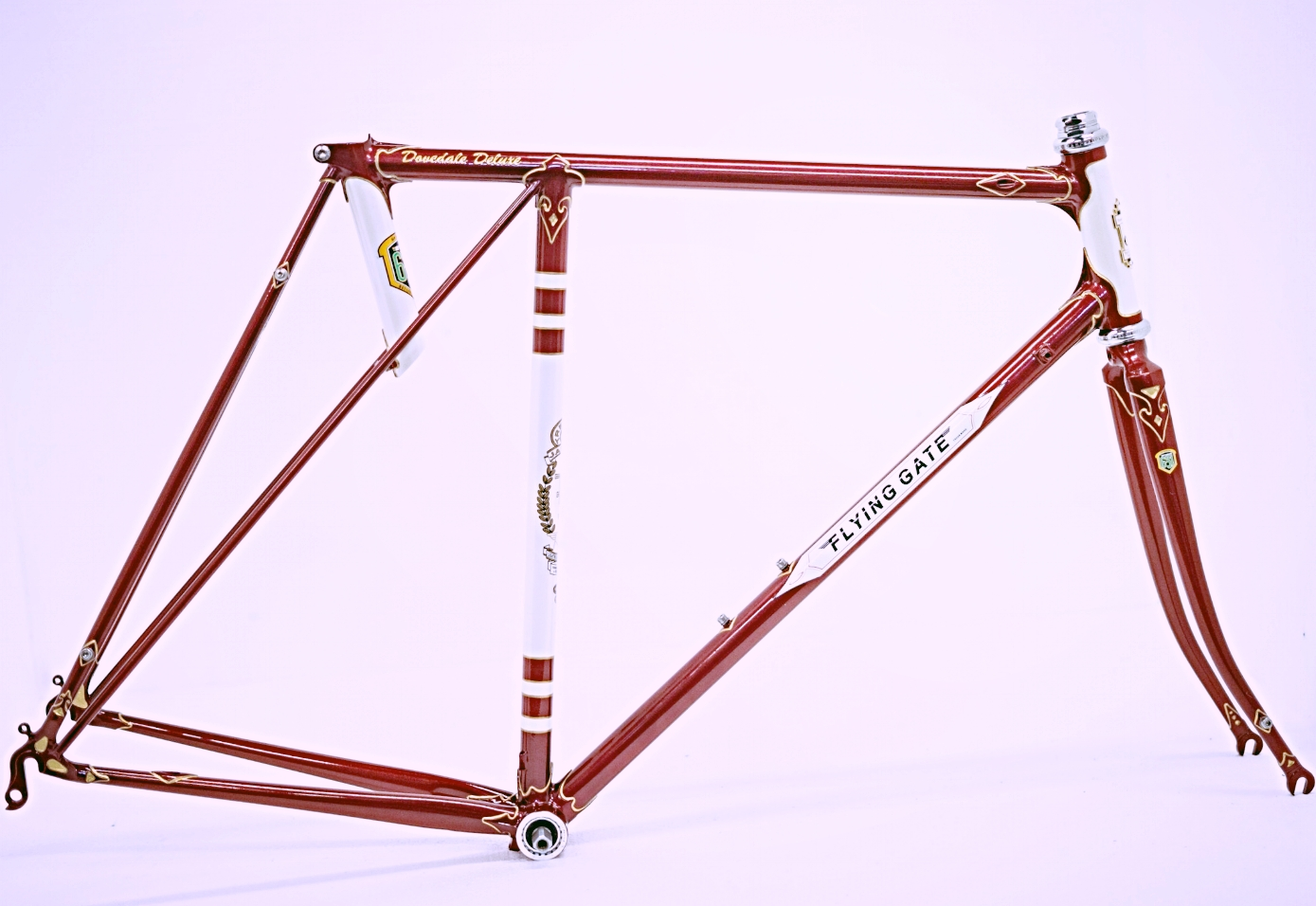 Handbuilt in Reynolds 631 - Dovedale Deluxe featuring concealed brake and gear cable routing. Flam ruby with pearl white panels and gold luglining. Photos  Jonny Keeley .