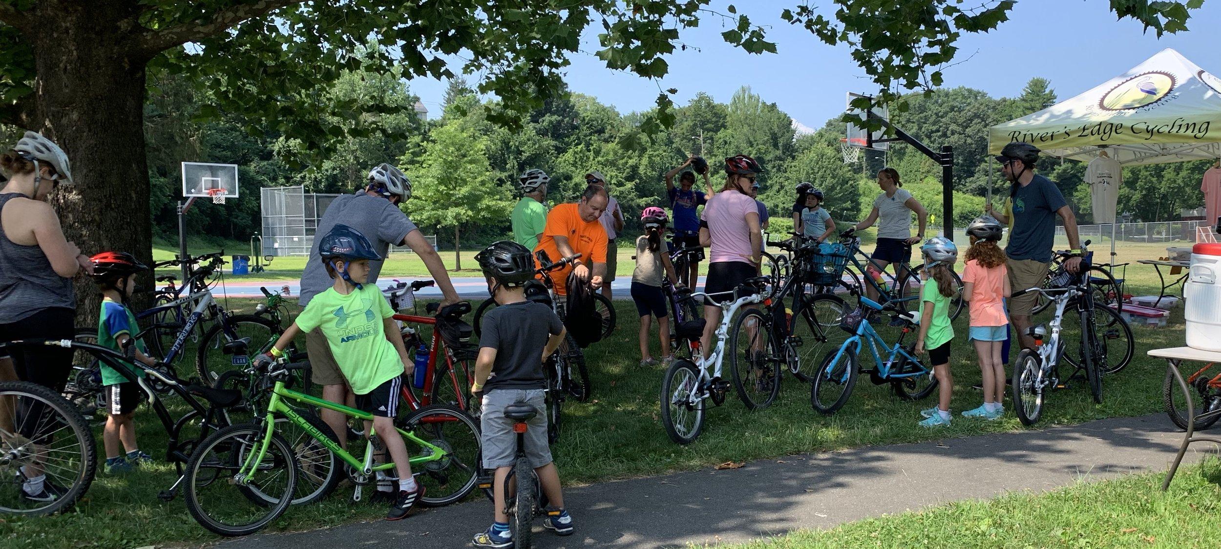 Families prepare to roll on the Kiddie Scoop Loop.