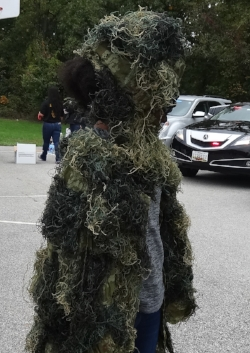 Middle school student in camouflage