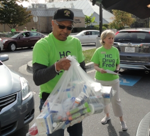 Columbia resident, Lt. Governor Boyd Rutherford removing medications and sharps from his home community.