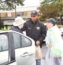 Lt. Governor Boyd Rutherford and HC DrugFree's Executive Director talking with residents as they collected meds/sharps in the rain.