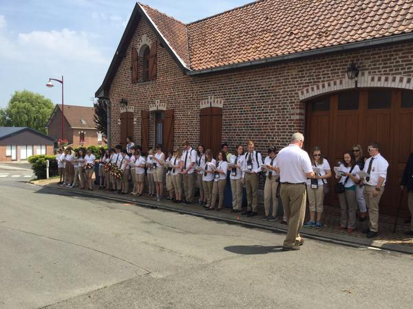 Students read the names of those lost at Monchy