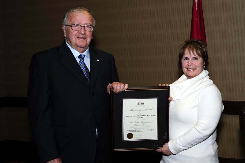 T. Alex Hickman presenting a Manning Award to Carbonear Historic Walking Tours in 2011.