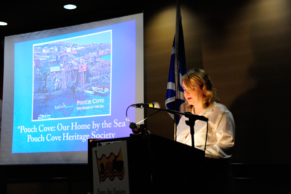 "Ms. Katie Harvey, HSA board member, speaks on a project in the Community Category, ""Pouch Cove: Our Home by the Sea""."