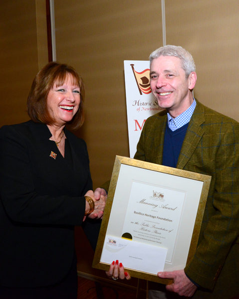 """Her Honour, Mrs. Patricia Fagan, presents the Manning Award to Mr. Paul Rowe, playwright of """"Fleming""""."""