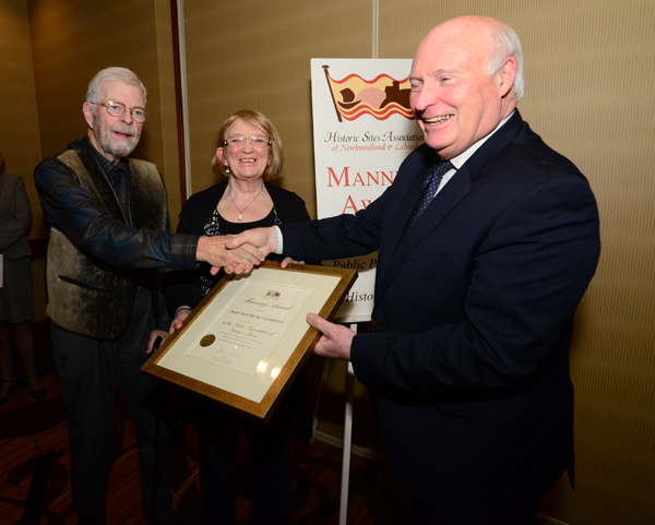Pictured with the Manning Award are Mr. Chris Collingwood, Co-Chair of the project's Capital Campaign Committee, The Honourable John C. Crosbie, former Lieutenant Governor of Newfoundland and Labrador and patron of the Sealers Memorial campaign, and Ms. Mrtyle Stagg, chair of the Home from the Sea Foundation.