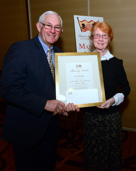 His Honour, The Honourable Frank F. Fagan, presents the Manning Award for Outstanding Heritage Supporter to Dr. Jo Shaywer.