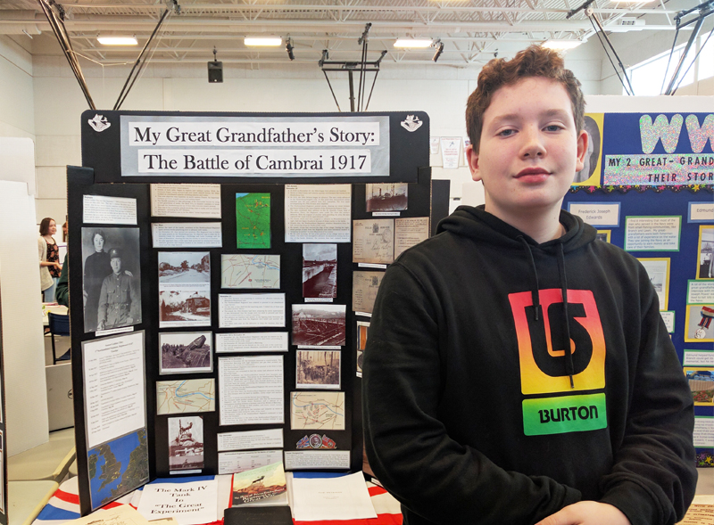"""Michael Moss  Grade 8, Beaconsfield Junior High Avalon Regional Heritage Fair  """"My Great Grandfather's Story: Cambrai 1917""""  My Heritage Fair project was a timeline of my Great-Grandfather's time in the First World War, his injuries, and his life afterwards. Also Includes daily details from the battle field documented in his photo albums."""