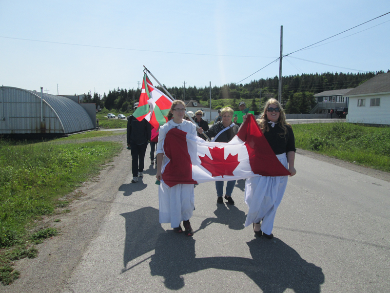 Parade heading to the Basque Buffet in Old Port au Choix
