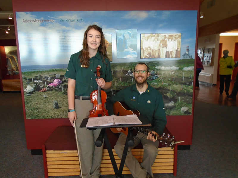 Parks Canada staff providing entertainment at the Port au Choix visitor center during the first day of the festival.