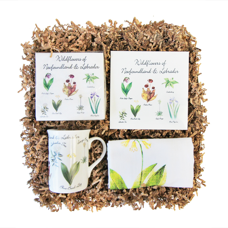 NL Wildflower Gift Box    Functional products featuring artwork of popular NL wildflowers   Choose From: Bone China Mug, Ceramic Trivet, Cocktail Napkins, Linen Tea Towel, Wildflower Seeds, Apron, or Guide Books