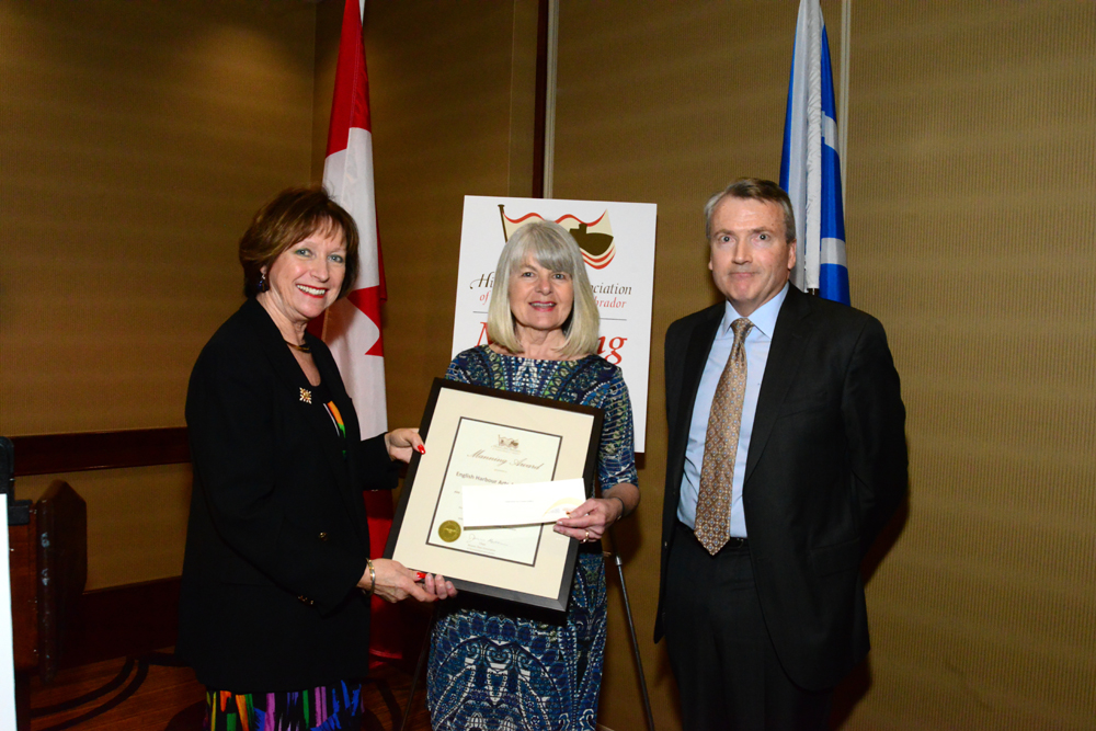 Kim Paddon, Director of the English Harbour Arts Association, accepts the Manning Award from Her Honour, Mrs. Patricia Fagan