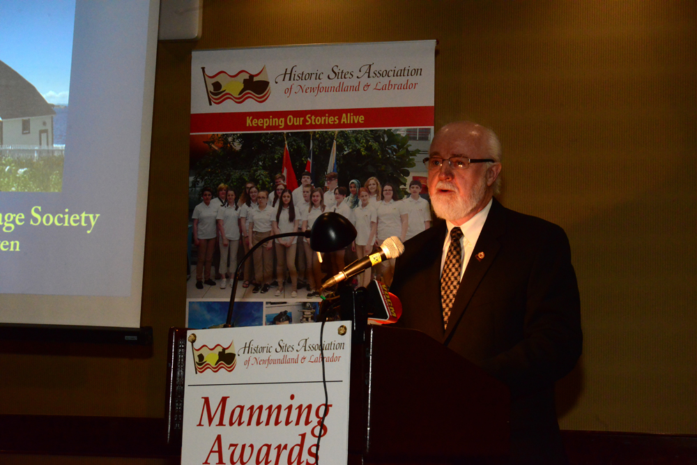 John Warren accepts the award as President of the Mizzen Heritage Society