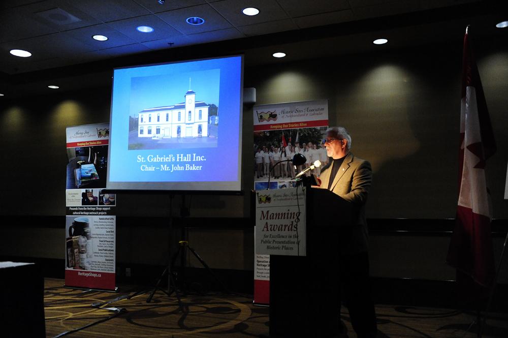 Chair John Baker accepts the award on behalf of St. Gabriel's Hall Inc.