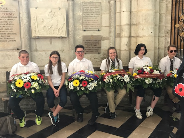 Students as wreath carriers and layers at Amien's Cathedral in France.