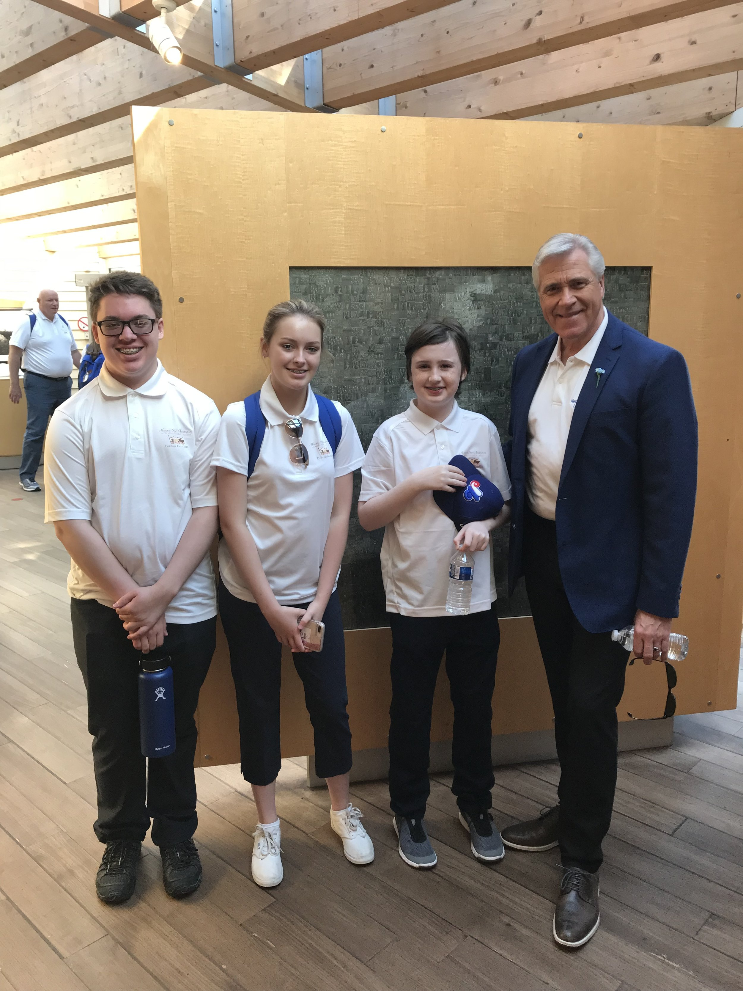 Students Kyle Pike, Emily O'Quinn and Liam Power with Permire Dwight Ball at the Newfoundland War Memorial Park in Beaumont-Hamel in France.