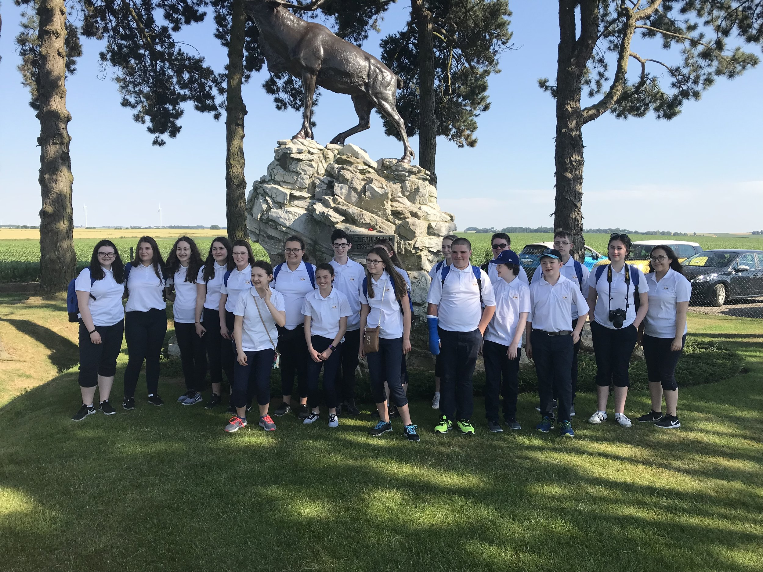 Student Ambassadors at the bronze caribou monument in Gueudecourt.