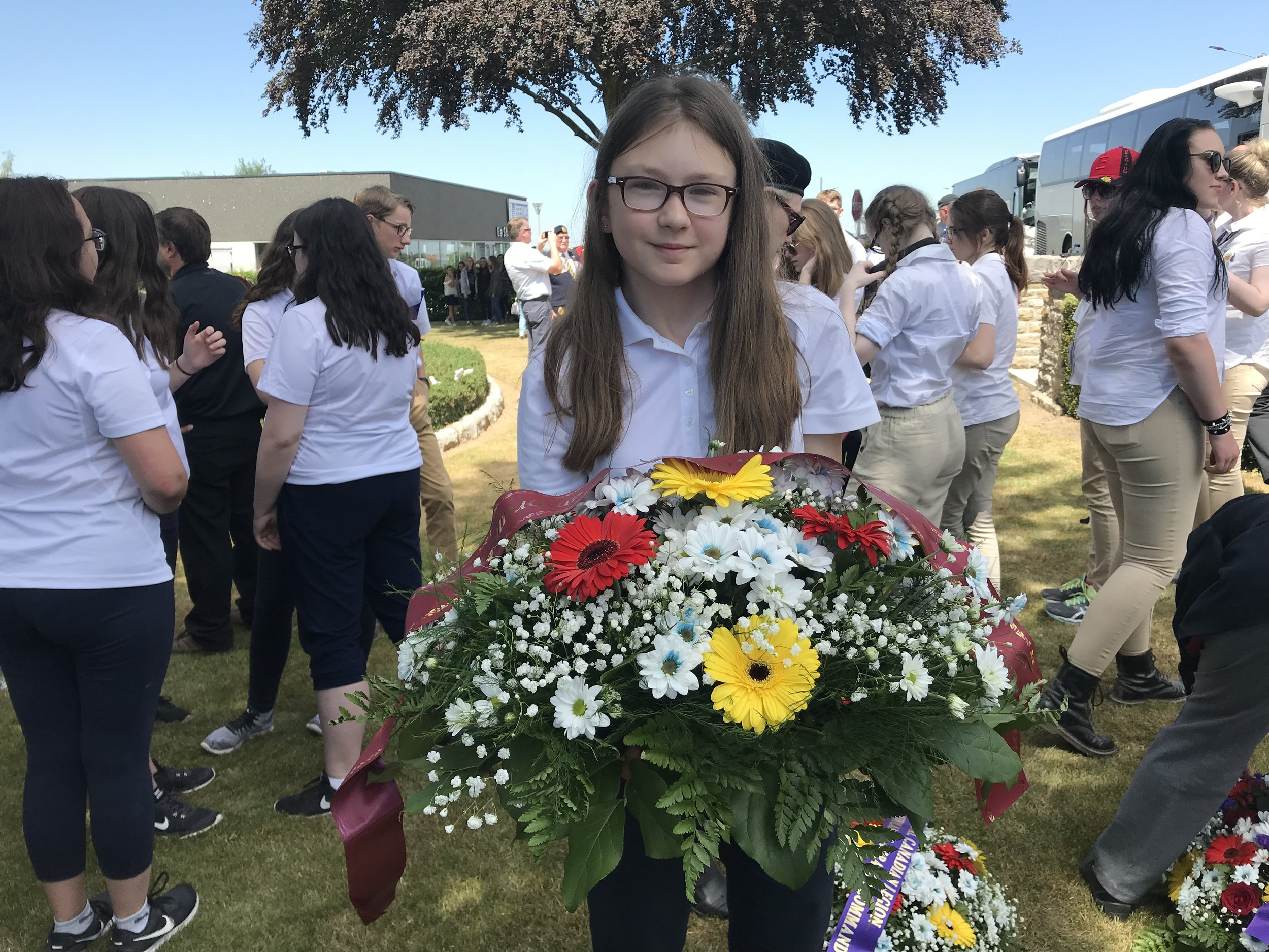 Student Shakira Rice as a wreath bearer in Masnieres.