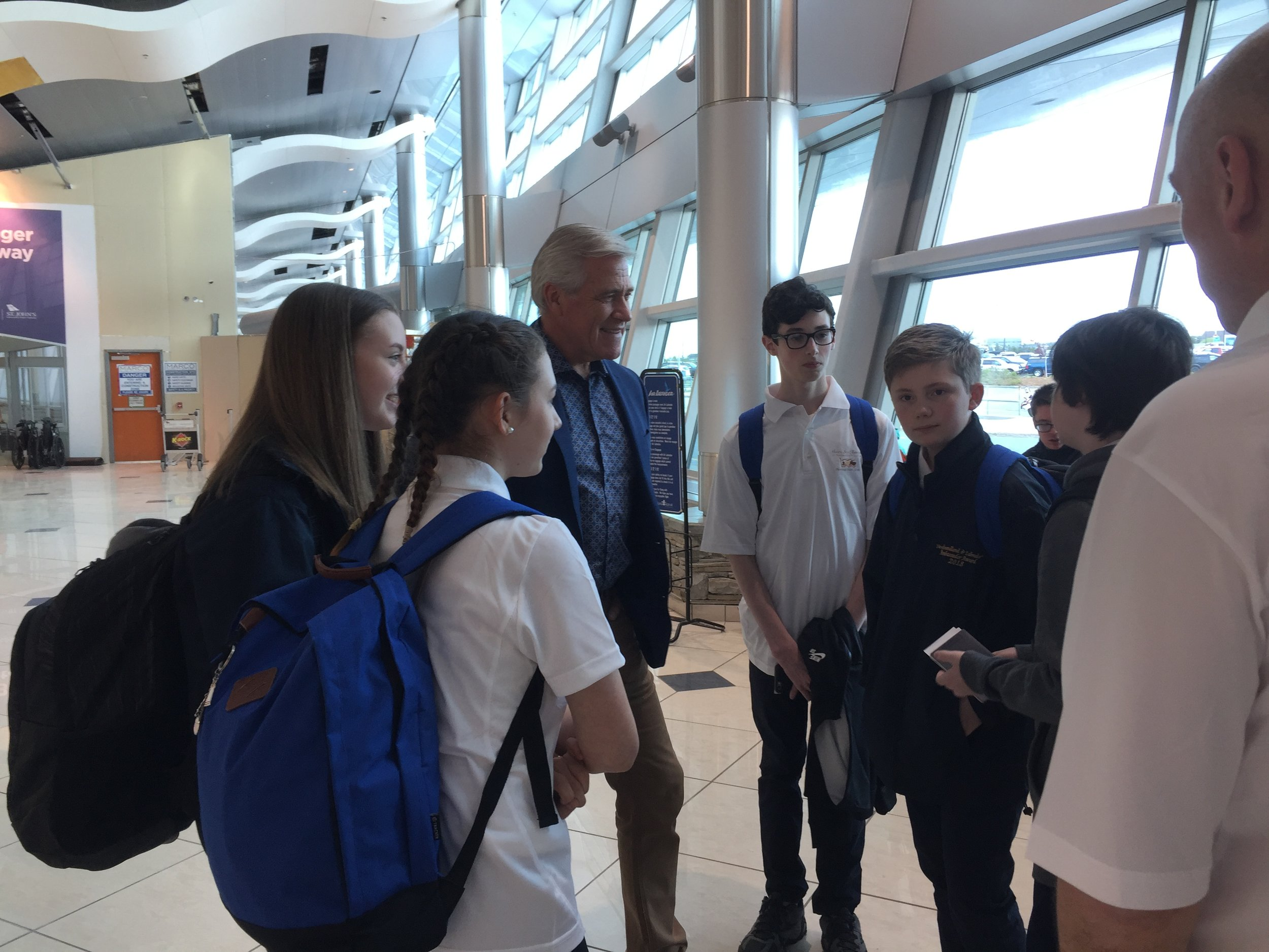 Premier Dwight Ball meeting with the ambassadors at St. John's internation airport before boarding the flight to Europe.