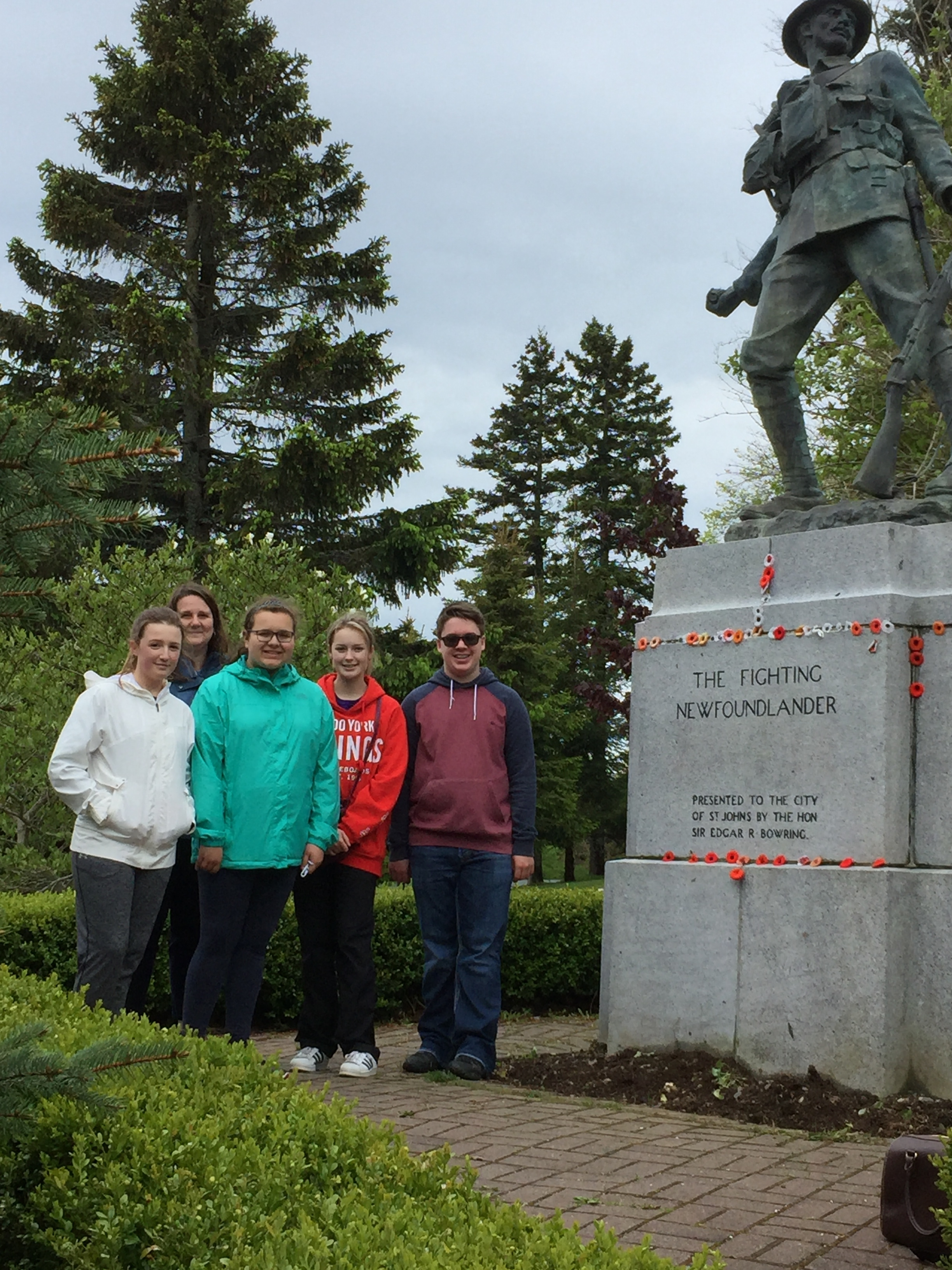 Student ambassadors from the west coast and chaparone Ms. Pittman-Baker at the Fighting Newfoundlander monument at Bowring Park in St. John's.