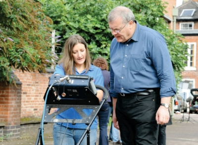 Richard Buckley, of the University of Leicester Archaeology service and Claire Graham of SUMO Geophysics review the on-screen data from the Ground Penetrating Radar.