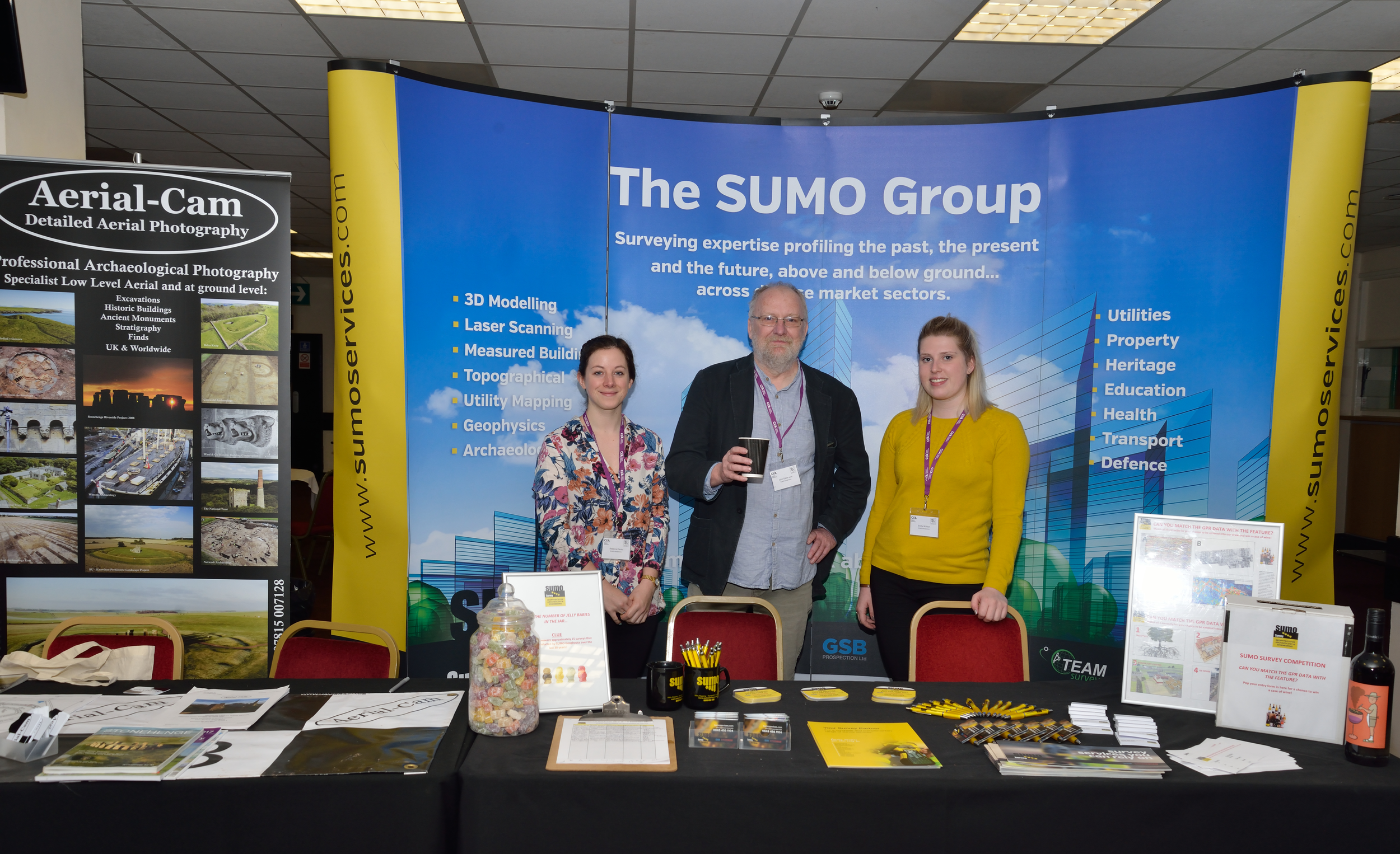 The SUMO Geophysics team ready at their stand. Left to right: Becky Davies, Dr John Gater, Emily Walton.