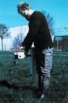 Dr. John Gater completing a near surface geophysics survey using a magnetometer