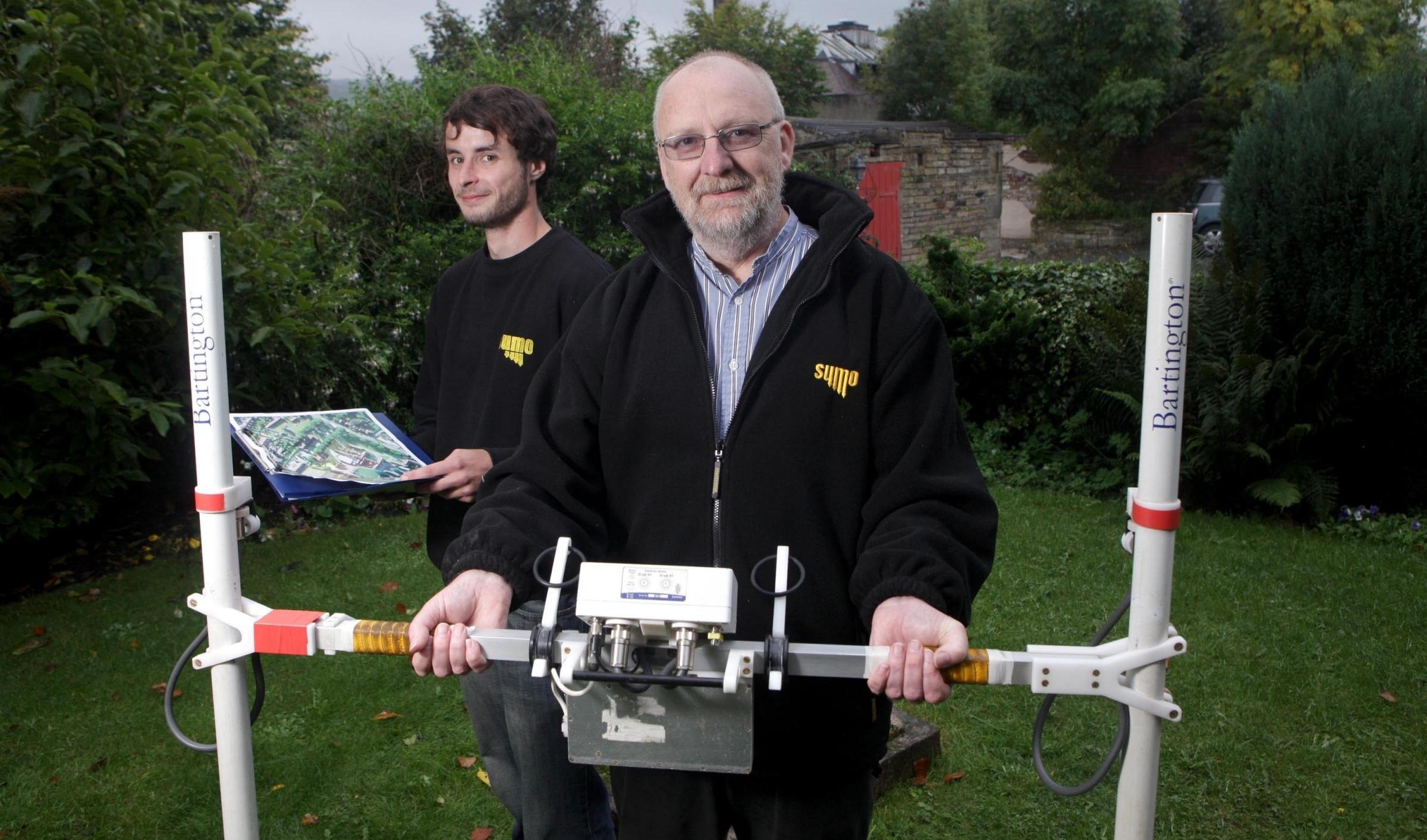 SUMO Geophysics Director Dr John Gater holding a geophysical magnetometer.