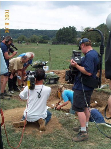 4. The excavation of the feature and a camera being inserted through a small hole which opened at the surface.