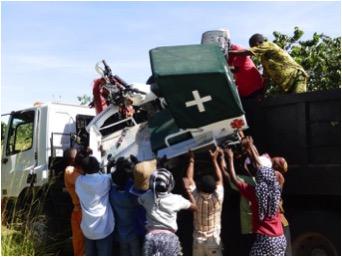 Guludo and Nema staff unloading the ambulances.