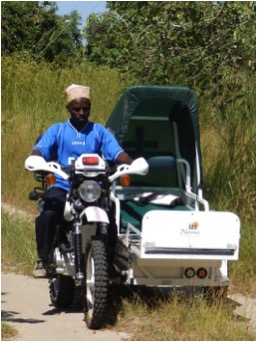 Team leader, Assane Mussa, driving testing the bikes!