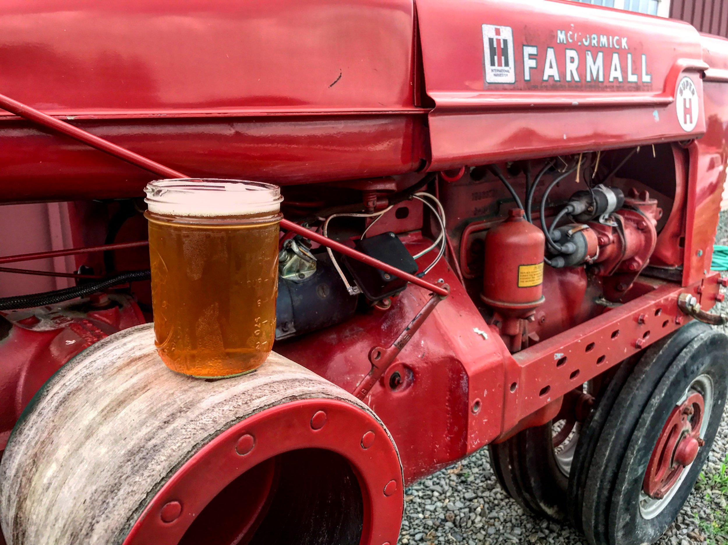 Picture of cider on red tractor