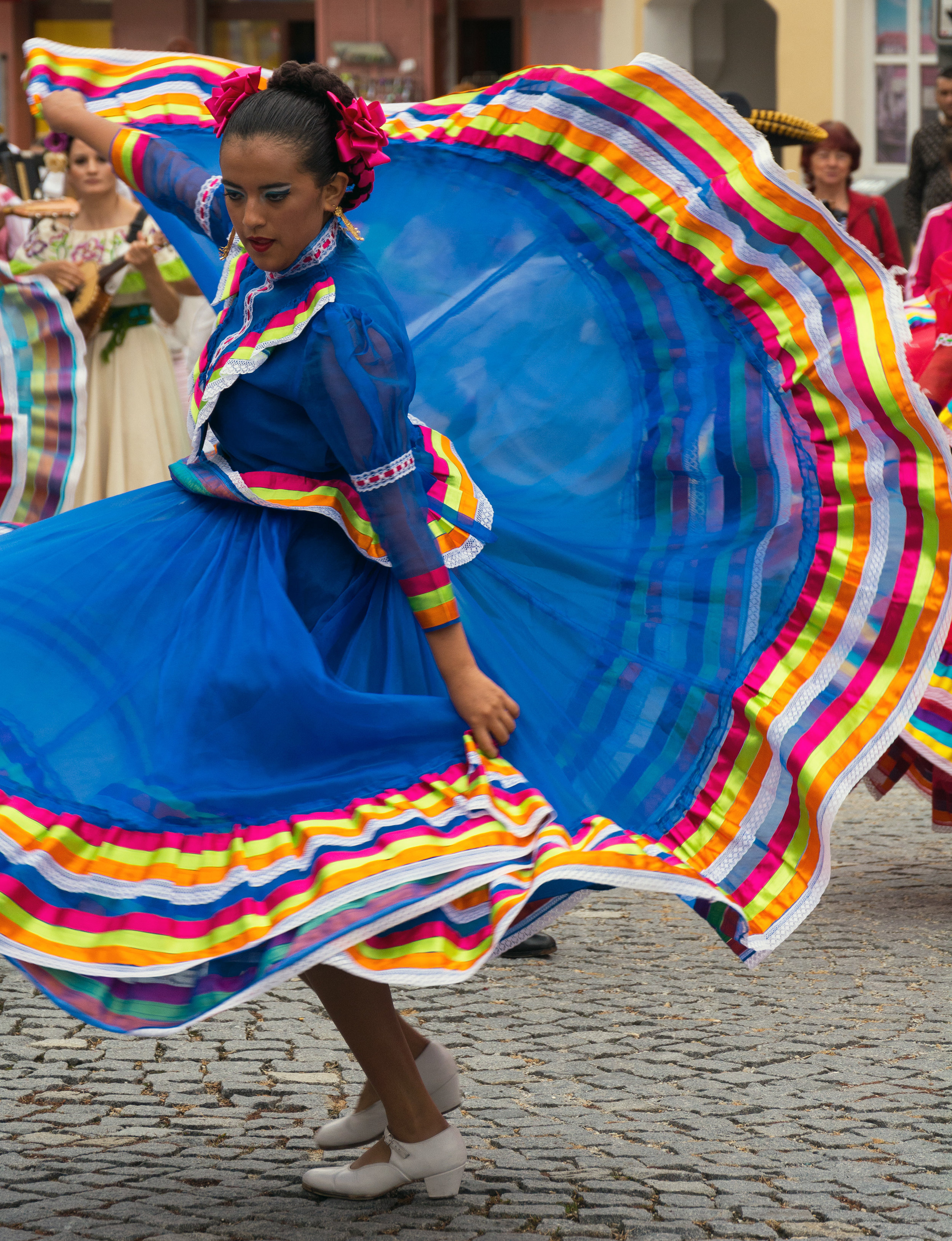 Dancing woman in traditional mexican dress.jpg