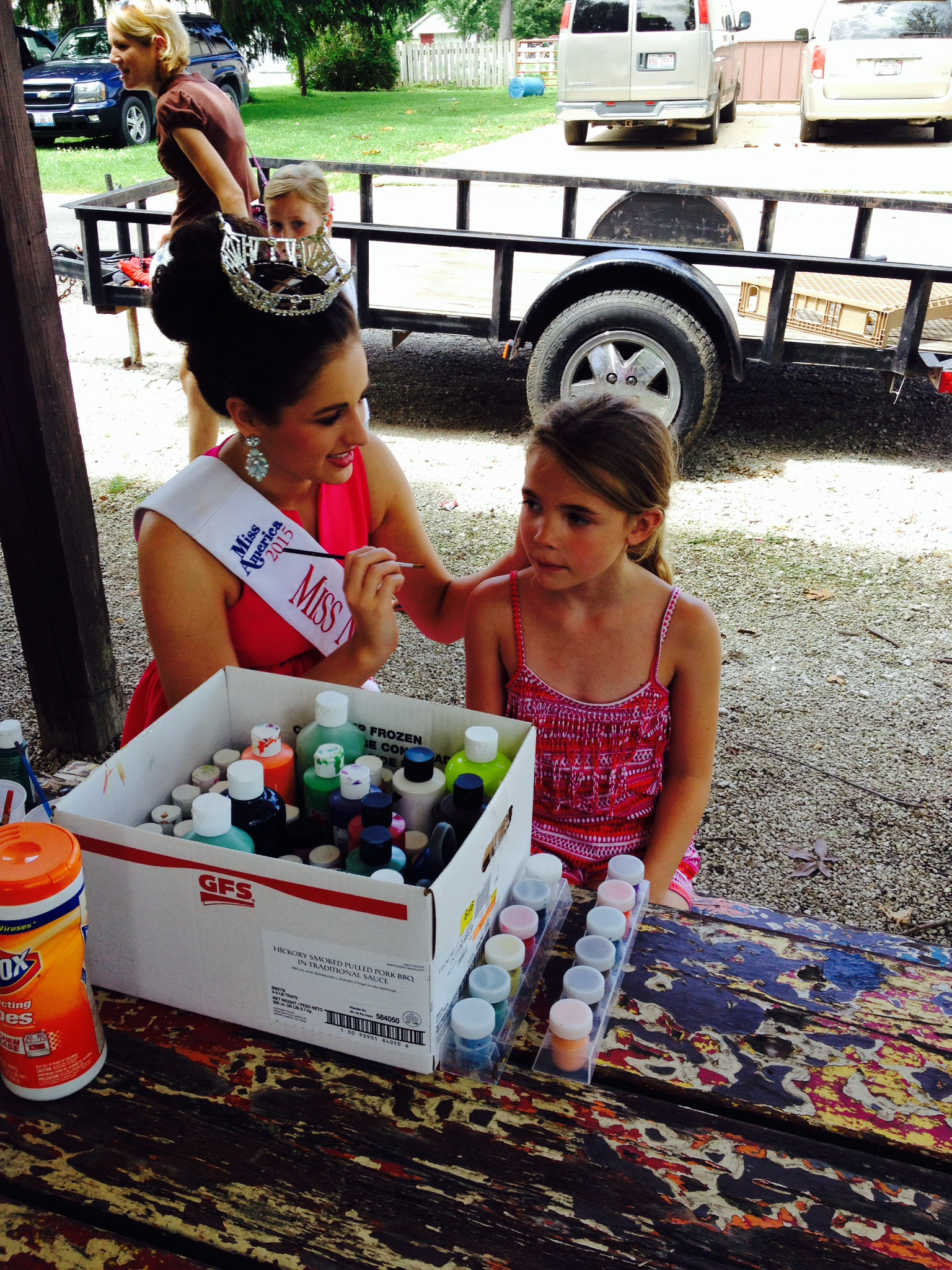 2015 Miss Northern Illinois Hannah Mayberry took time out of her busy schedule to visit the Outreach Community Center's Booth and even enjoyed doing some face painting for a young fan.