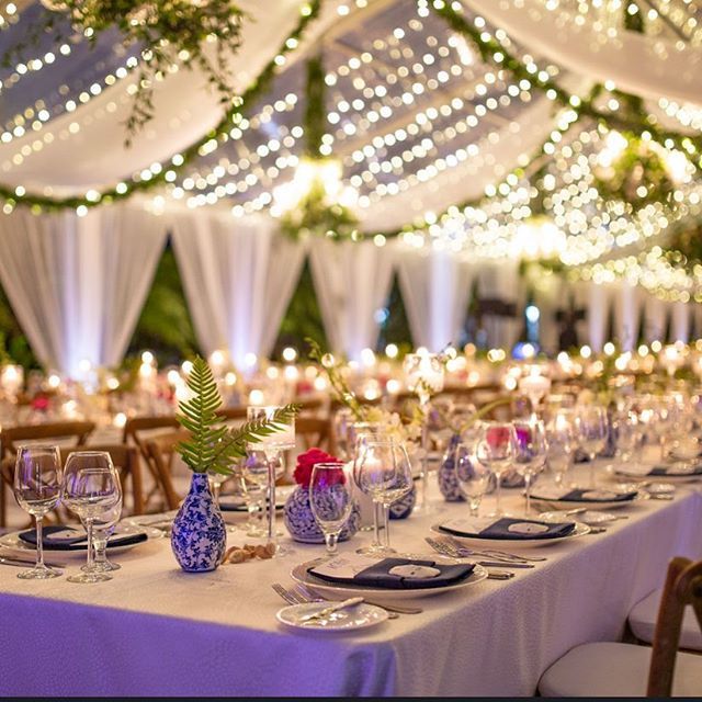 There's nothing like the soft glow of candle light and the twinkling of string lights in a tent... 🕯 🔥 * * * 📸 @f.dot242  #twinkle #candles #wedding #tentit #wildflowers #wedding2019 #bahamaswedding #lyfordcay #bahamas