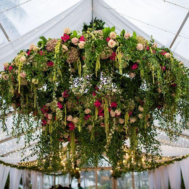 Yes we love floral chandeliers 💐🌺🌷 * * * #floralchandelier #weddings #bahamaswedding #flowers #weddings2019 #wildflowers #tent #hang  #bahamas