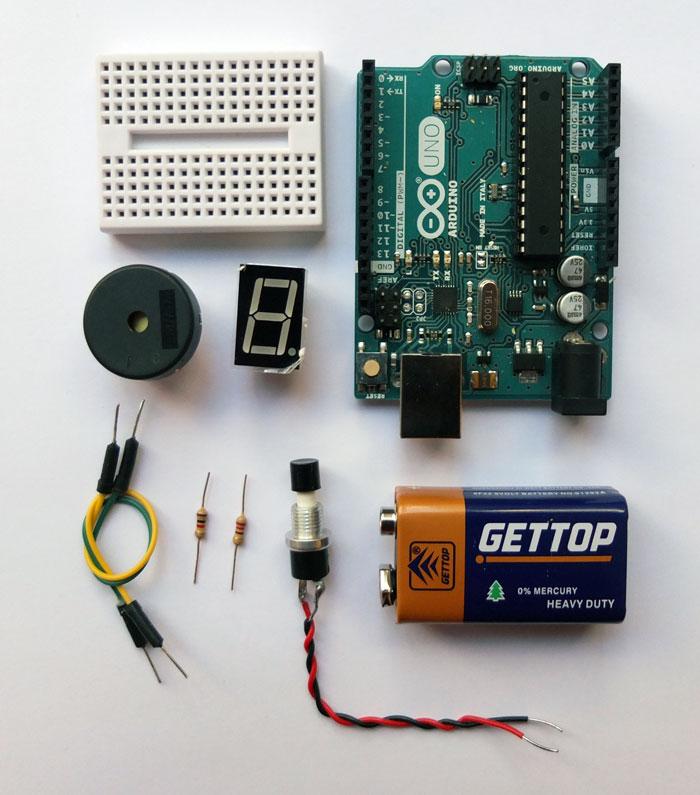 Components inside Game Controller:Mini Breadboard, Piezo, 7 Segment Display, Arduino Uno, Wires, Jumper Wires, Resistors (220 Ω, 1K  Ω ), n/o Switch, 9v Battery