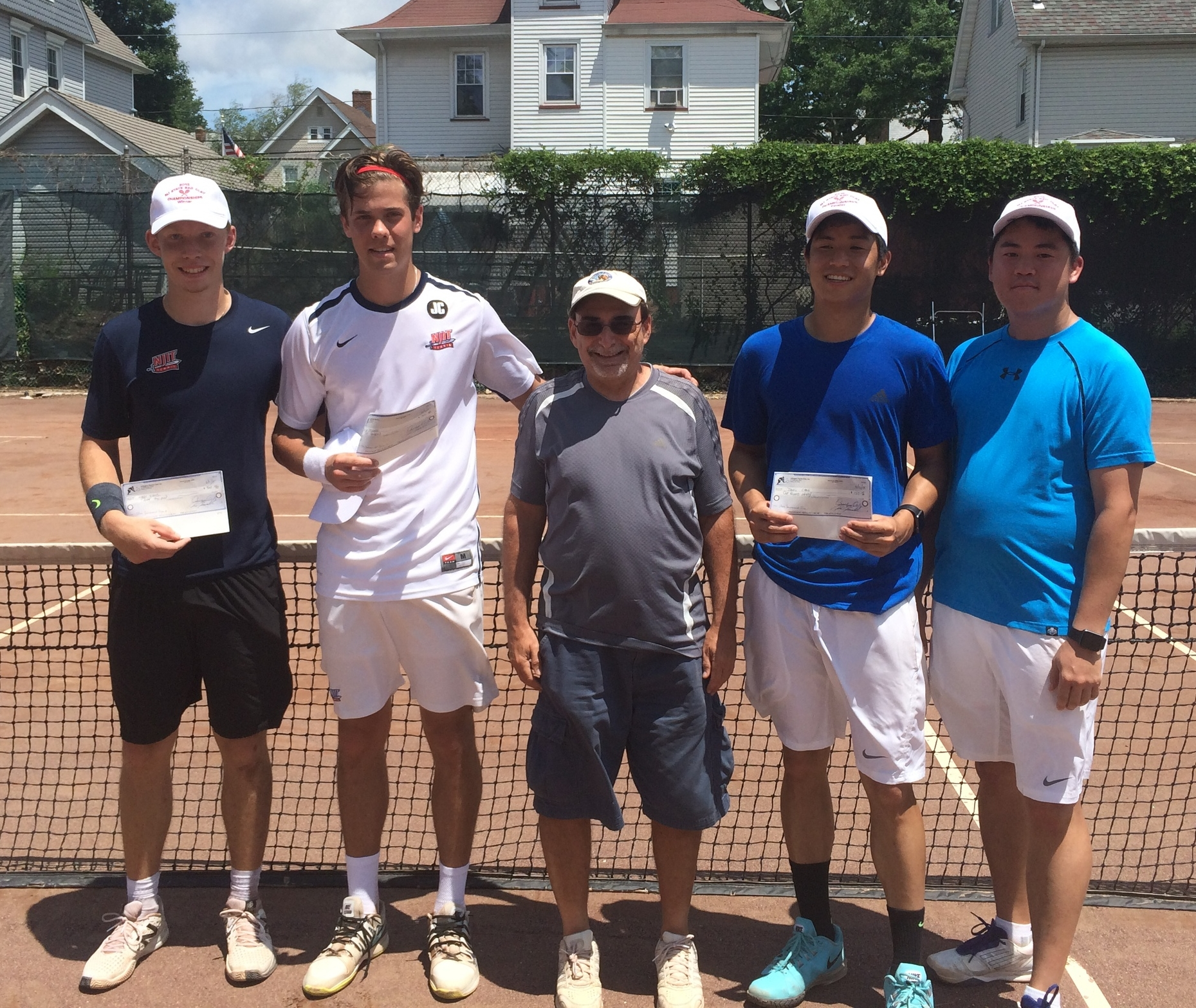 2015 Men's Doubles Winners, Markus Schultz & Carl Jedlinski (left), Tournament Director, Bernie Lebofsky (center) & Runners-ups, Daniel & Timothy Chang (right)