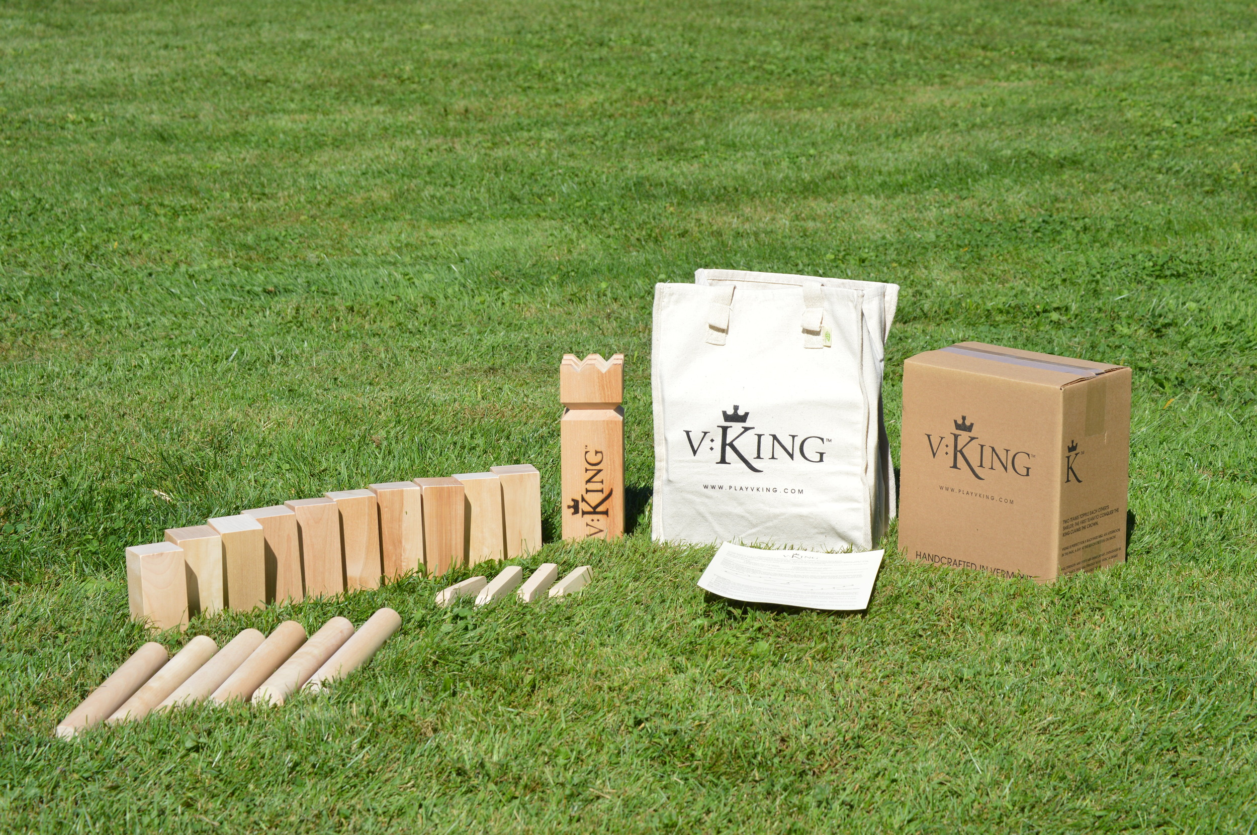 V:King Set handcrafted in Vermont includes:  10 Shields  6 Battle Axes  1 King  4 Field Markers  1 Cotton Canvas Storage Bag  1 Rule Sheet