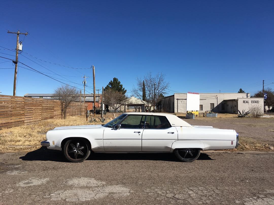 White car under blue sky
