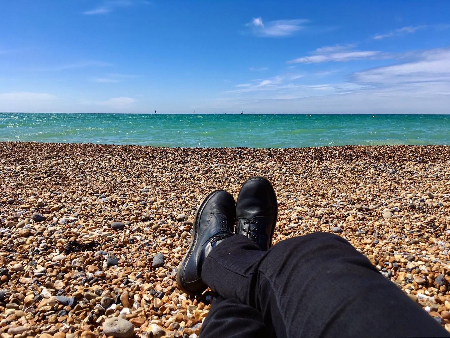 Working on my tan at the beach in Brighton.