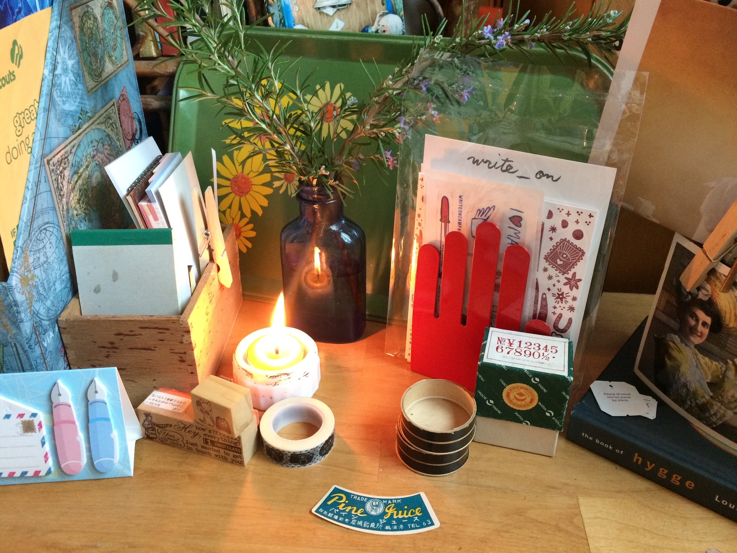 Carving out time to write in our often busy lives can be challenging.  Creating a warm and welcoming space to do so can help you make the time! Miss Polly readies her space by lighting a candle and arranging freshly plucked rosemary on her desk.
