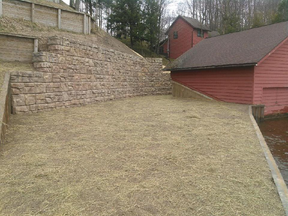 Redi-rock block retaining wall/yard/new steel seawall on Hamlin Lake