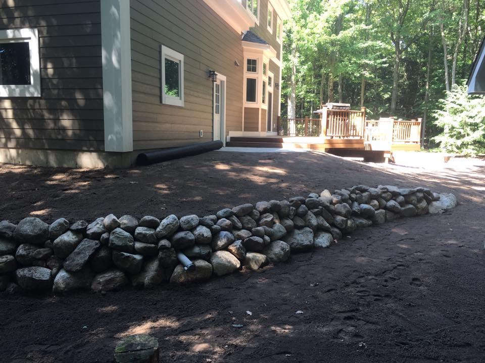 Natural rock retaining wall/yard