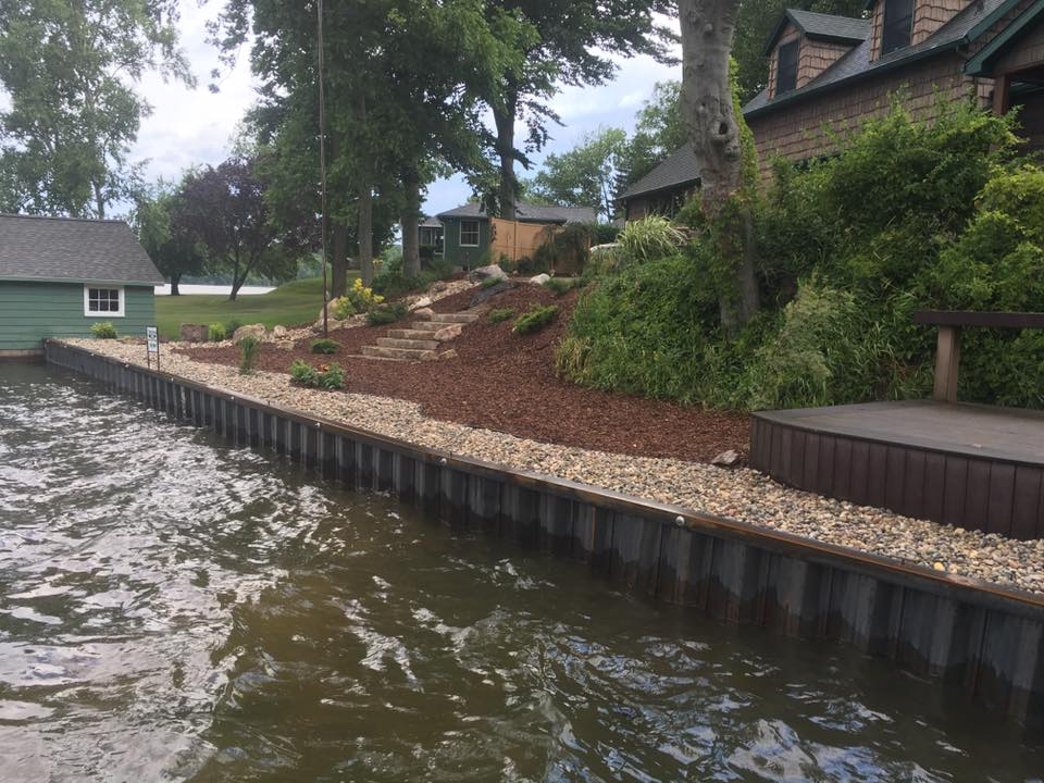 New steel seawall with landscaping on Hamlin Lake